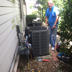 central air conditioner being repaired
